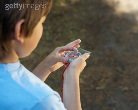 kid with compass picture