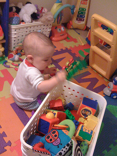 baby playing with toys pictures