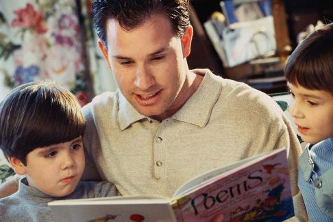 father son reading picture