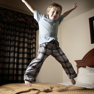 kid jumping on bed picture