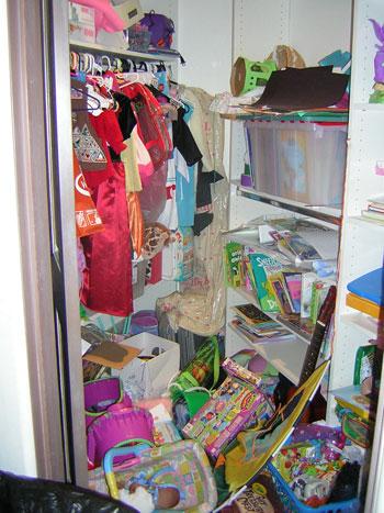 unorganized toy closet picture