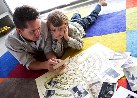 father and son playing reading picture