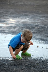 boy in mud picture