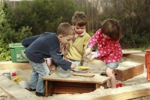 children in the sandbox picture