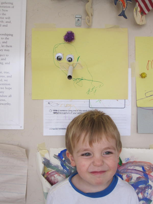 kid with his elephant drawing