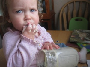 baby eating cream picture