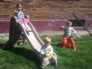 kids blowing bubbles pics