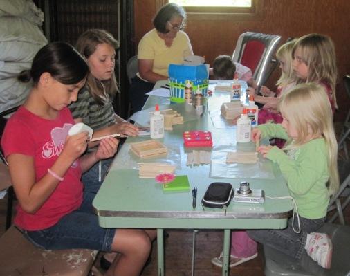 kids making popsicle stick crafts