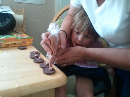 little girl decorating cookies pictures