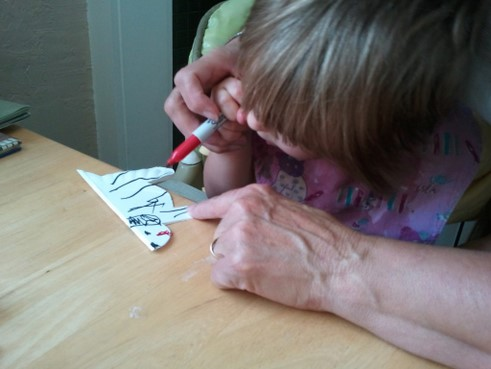 little girl drawing pictures
