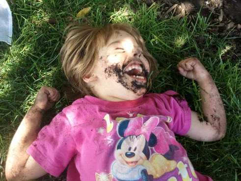 little girl playing in mud pictures