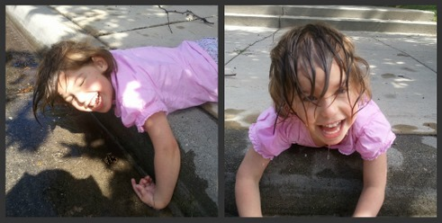 little girl playing in water