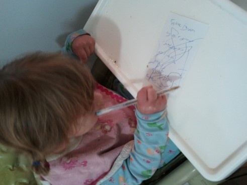 little kid with cerebral palsy writing