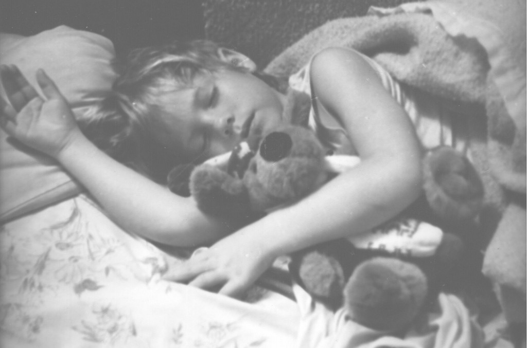 vintage photo of small girl sleeping