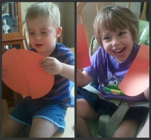 kids playing with semi circle shaped chart paper