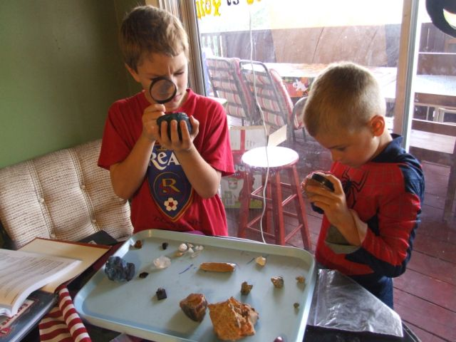 kids studying rocks and learning about them