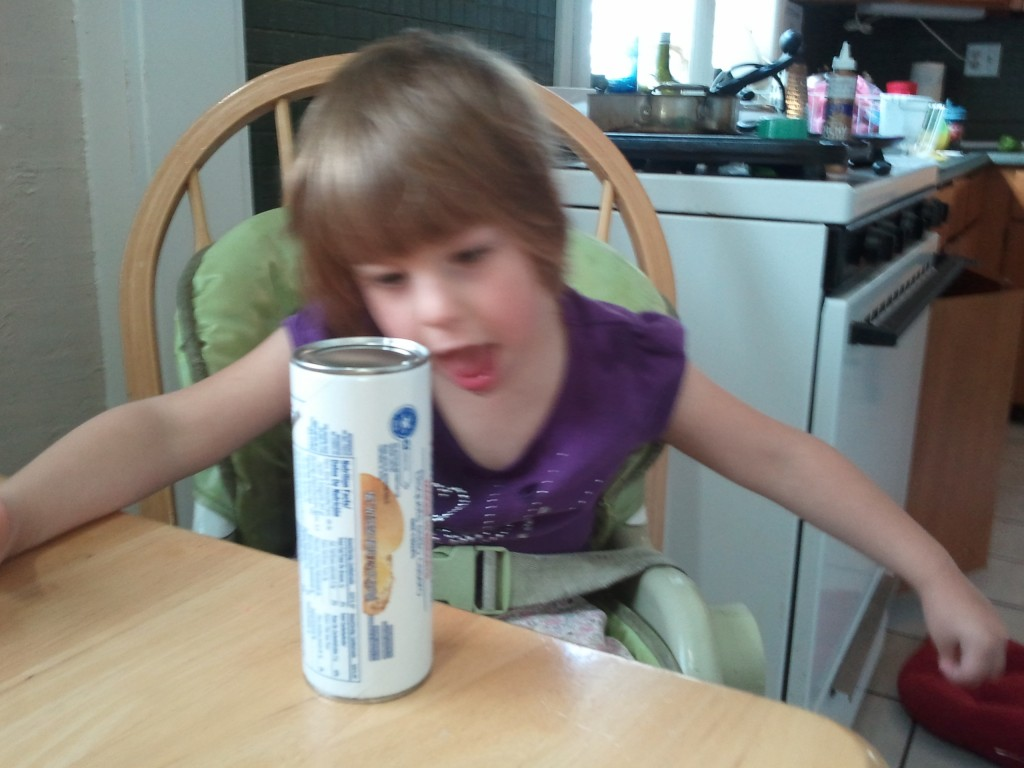 little girl with her baking roll