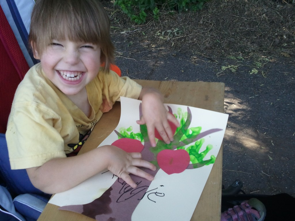 little smiling girl with her apple tree craft picture