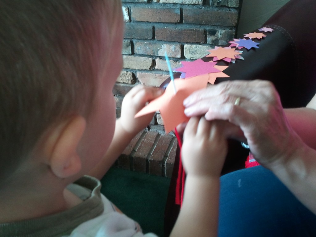 little boy Jack making his star mobile