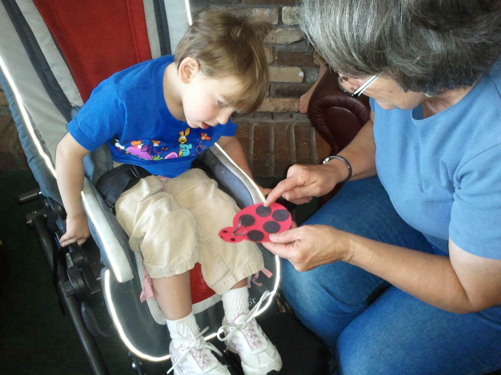 grandma and grand daughter making ladybug