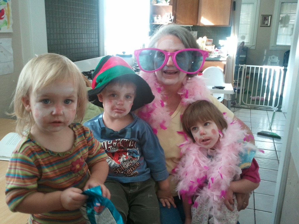 grandma and grandkids dressed as  clowns