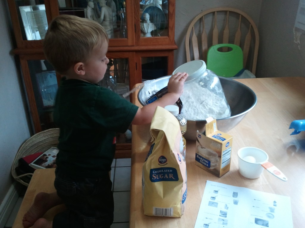 kid measuring for cookies picture