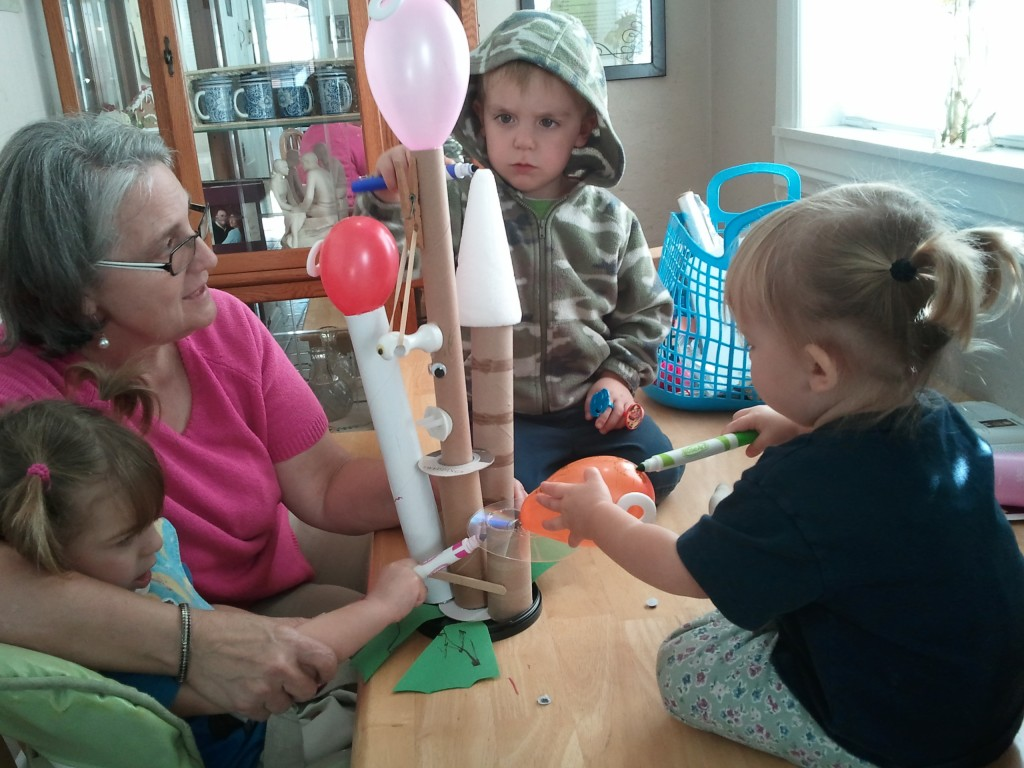 kids with their rocket propelled robot invention
