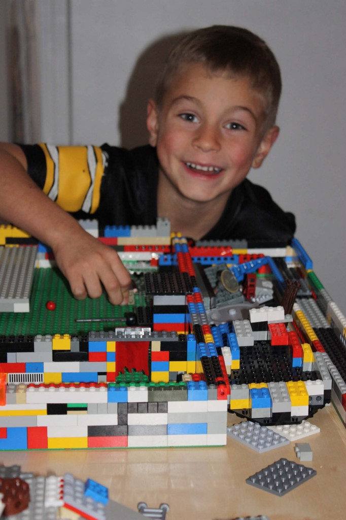 kid making legos structure picture