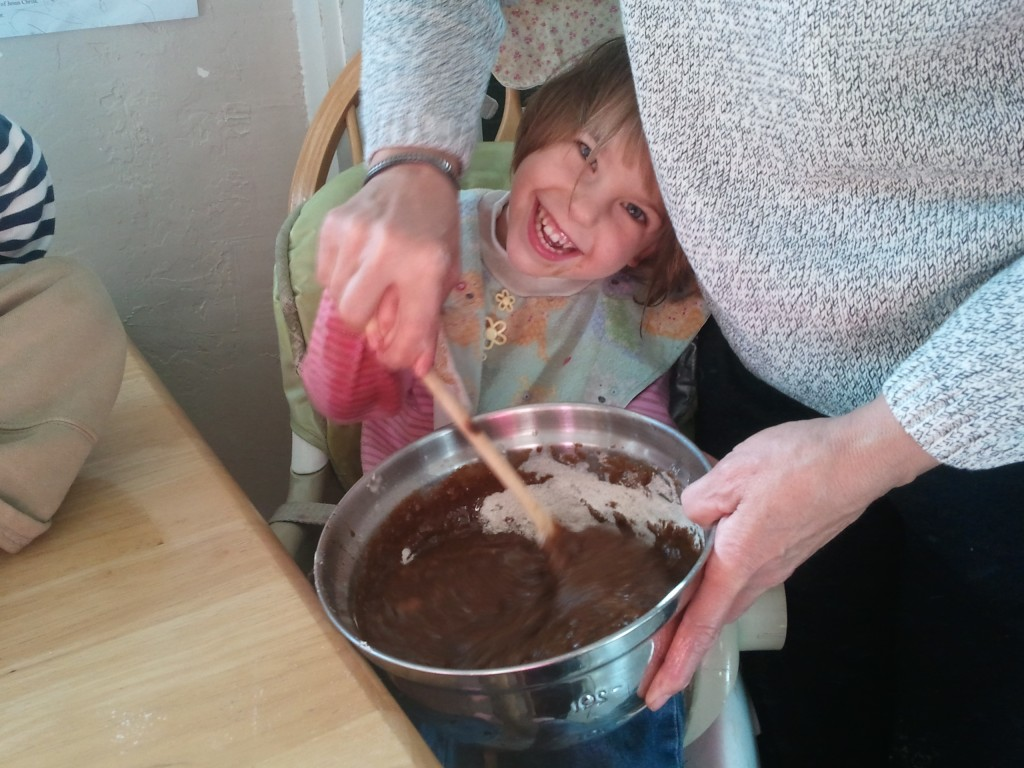 kids making muffin batter
