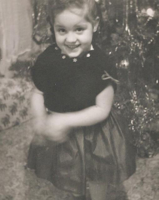 black and white photo of little girl smiling