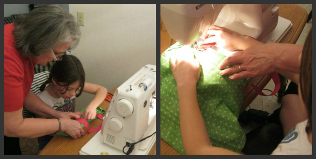little girl learning to sew on machine