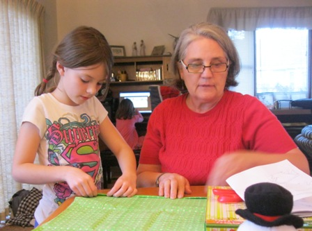 picture of little girl learning to sew from grandma