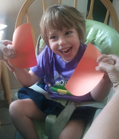 little girl with cerebral palsy proud of her own creation