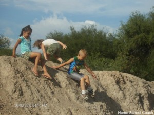 children playing on rock  pic