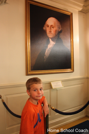 kid with president epcot picture