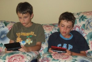 kids busy playing ps3 picture
