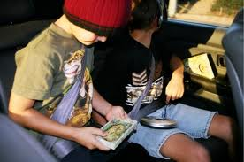 kids listening to books in car picture
