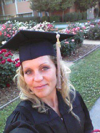Jenny in graduation gown cap