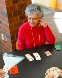 old lady playing bridge picture