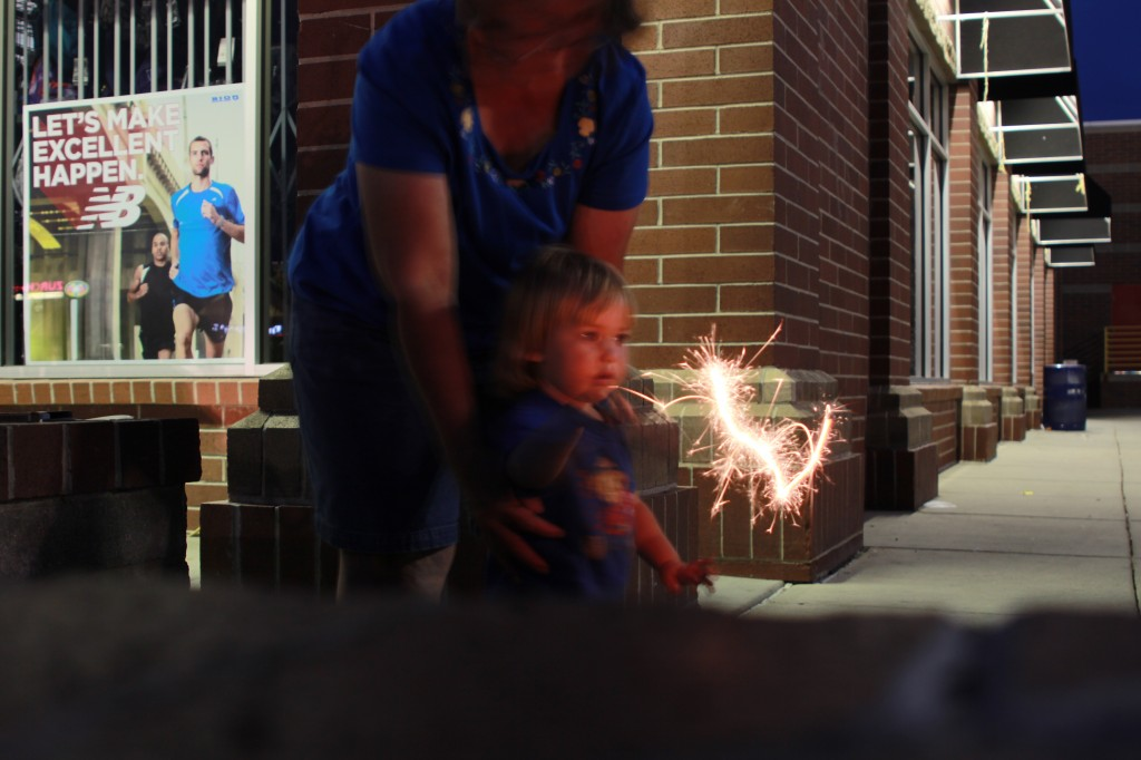 kid with sparklers picture