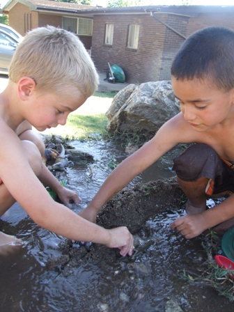 Boys playing in the mud