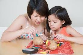 girl and mom making a battery operated light bulb