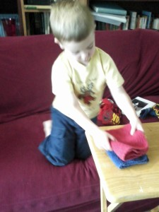 Jack folding dish towels.
