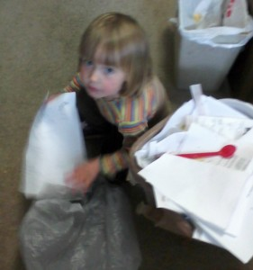 Mary emptying garbage