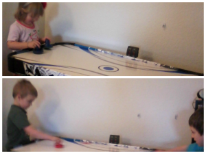 girls and boys playing air hockey